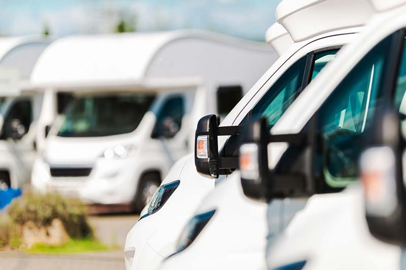 Parking lot filled with recreation vehicles for sale  after an rv inspection